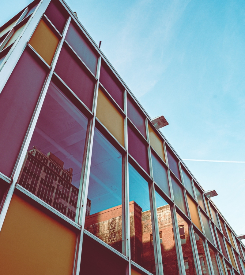 low-angle-photo-of-glass-building-2472270